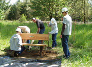 Wolf Creek Job Corp, Ray Jensen and John Malone installing new bench on Nature Trail